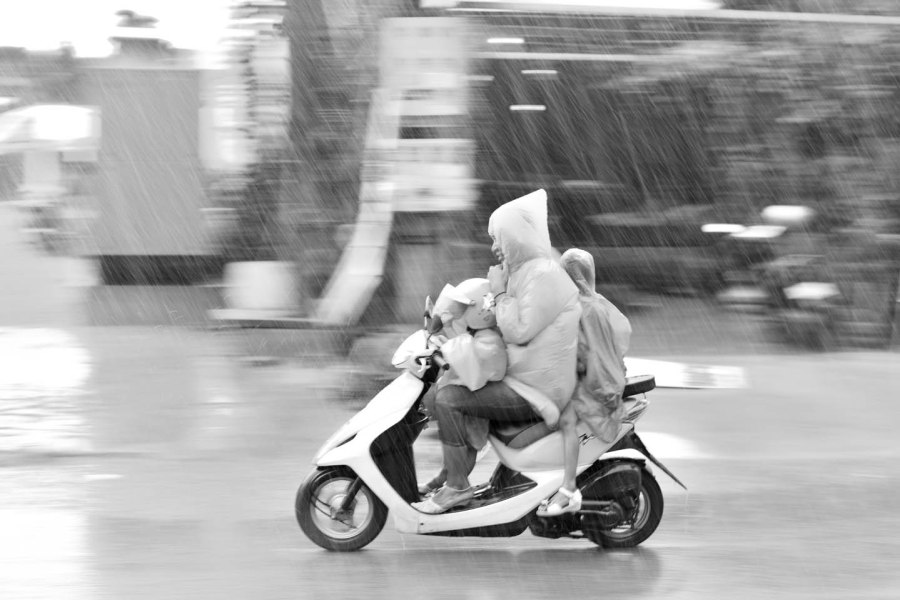 Motorbike ridind during an storm in Seam Reap