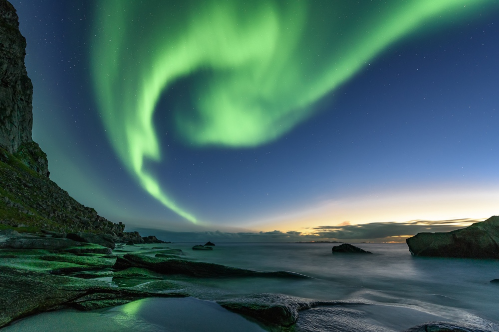 Northern lights about a beach in Lofoten islands, Norway